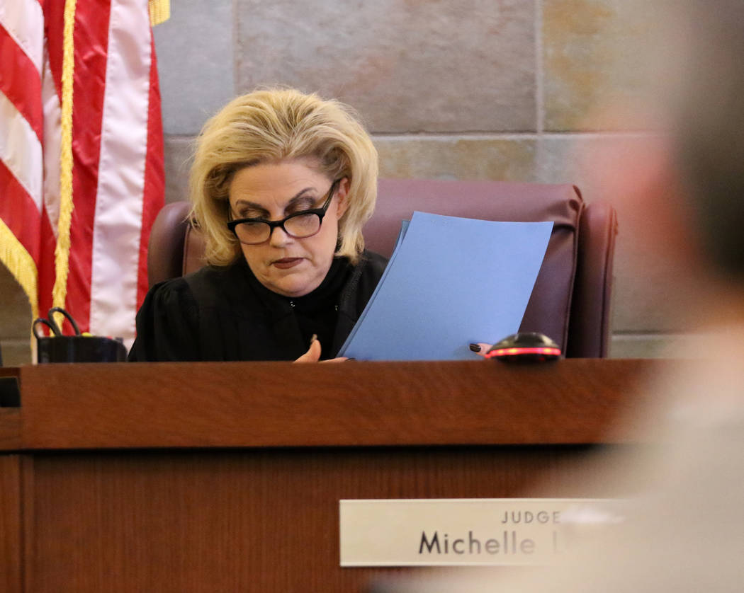 Judge Michelle Leavitt looks over the document containing the verdict for Emilio Arenas at the Regional Justice Center in Las Vegas, Friday, Feb. 1, 2019. Arenas received life in prison without th ...