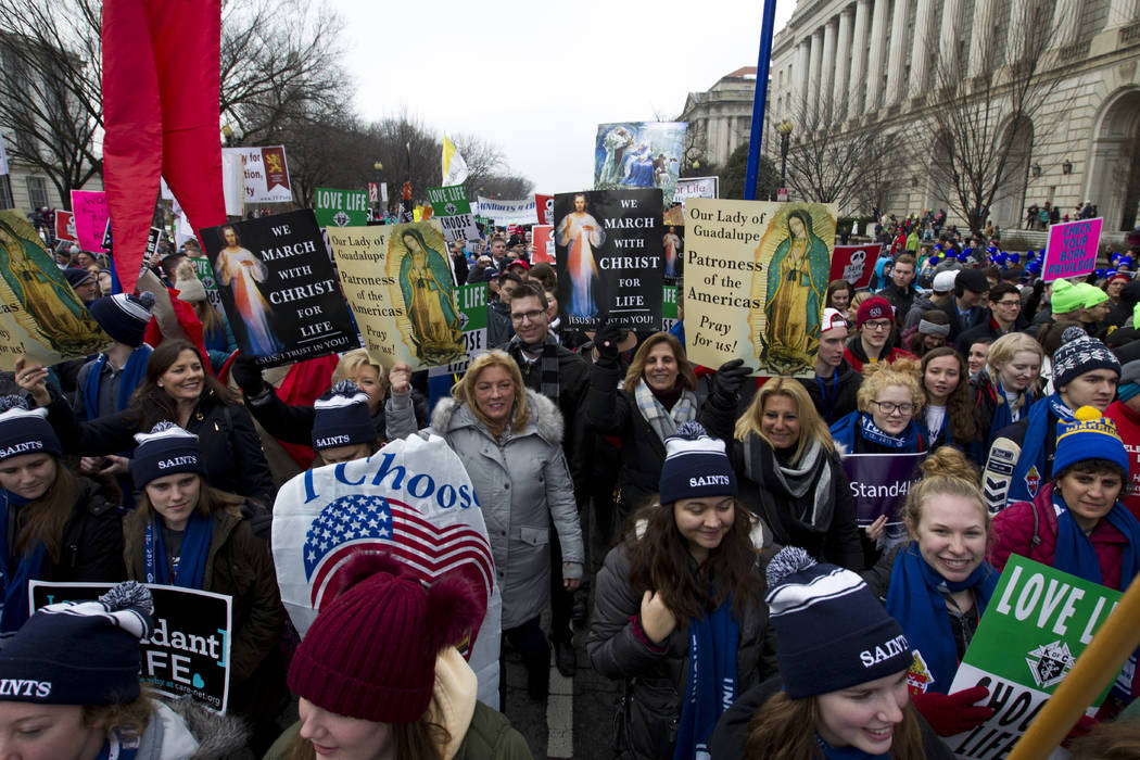 Anti-abortion activists march towards the U.S. Supreme Court during the March for Life in Washington, Friday, Jan. 18, 2019. (AP Photo/Jose Luis Magana)