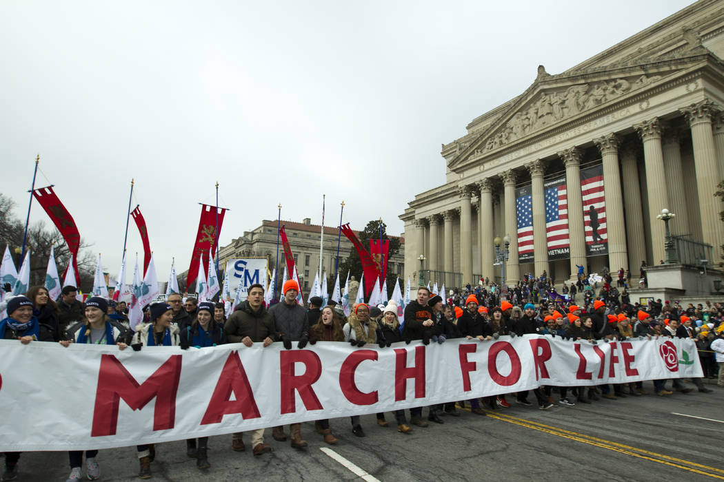 Anti-abortion activists march towards the U.S. Supreme Court during the March for Life in Washington Friday, Jan. 18, 2019. (AP Photo/Jose Luis Magana)