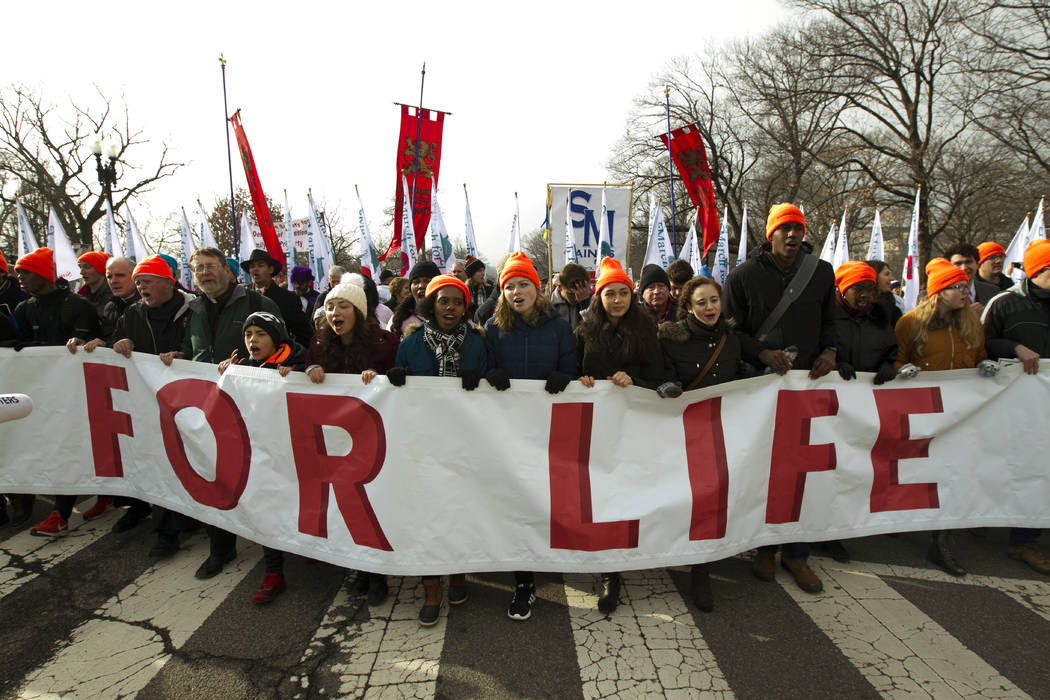 Anti-abortion activists march towards the U.S. Supreme Court, during the March for Life in Washington, Friday, Jan. 18, 2019. (AP Photo/Jose Luis Magana)