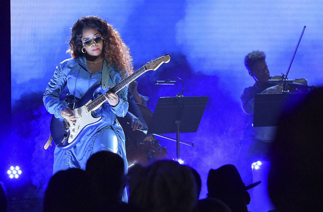 H.E.R. performs at the BET Awards at the Microsoft Theater in Los Angeles on June 24, 2018. (Richard Shotwell/Invision/AP, File)