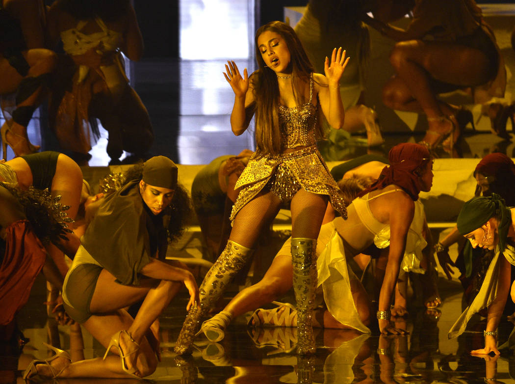 "Ariana Grande, center, performs ""God is a woman"" at the MTV Video Music Awards at Radio City Music Hall on Monday, Aug. 20, 2018, in New York. (Photo by Chris Pizzello/Invision/AP)"