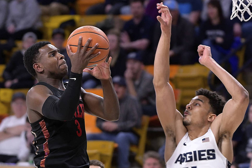 UNLV guard Amauri Hardy (3) shoots as Utah State forward Alex Dargenton (11) defends during an NCAA college basketball game Saturday, March 3, 2018, in Logan, Utah. (Eli Lucero/The Herald Journal ...