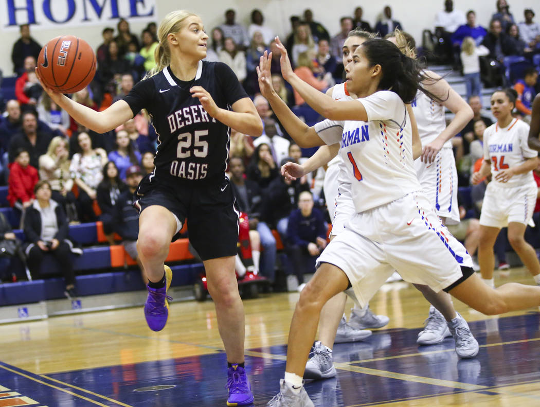 Desert Oasis' Melissa Simmons (25) looks to pass to keep the ball in under pressure from Bishop Gorman's Caira Young (1) during the second half of a basketball game at Bishop Gorman High School in ...