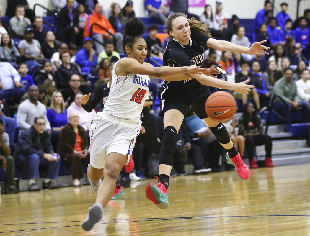 Bishop Gorman's Maleah Turner (10) tries to intercept a pass intended for Desert Oasis' Sierra Mich'l during the second half of a basketball game at Bishop Gorman High School in Las Vegas on Frida ...