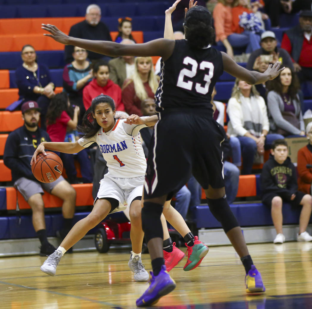 Bishop Gorman's Caira Young (1) drives the ball against Desert Oasis during the first half of a basketball game at Bishop Gorman High School in Las Vegas on Friday, Feb. 1, 2019. (Chase Stevens/La ...
