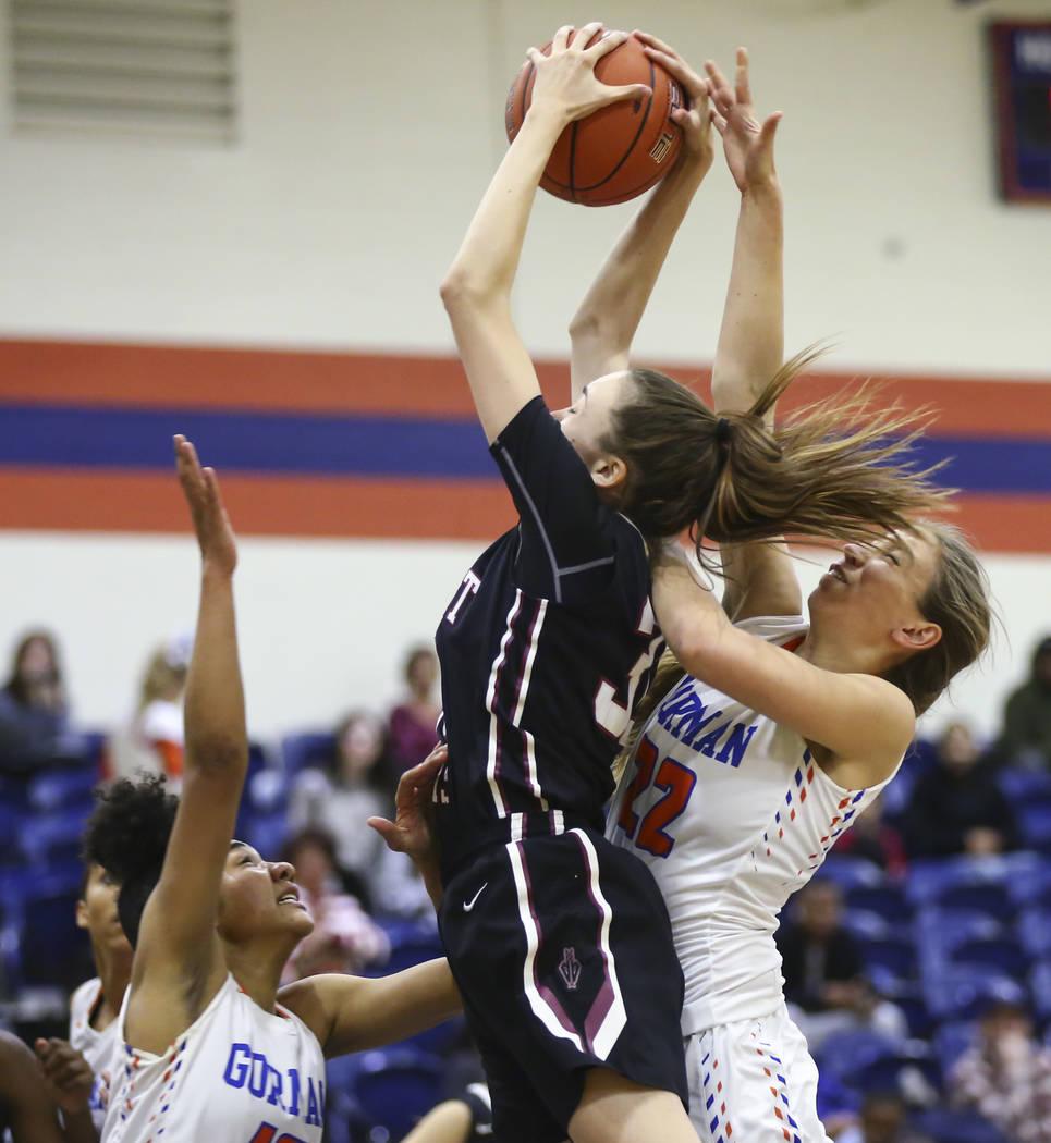 Desert Oasis' Sierra Mich'l, center, gets a rebound against Bishop Gorman's Lexi Kruljac (22) during the first half of a basketball game at Bishop Gorman High School in Las Vegas on Friday, Feb. 1 ...