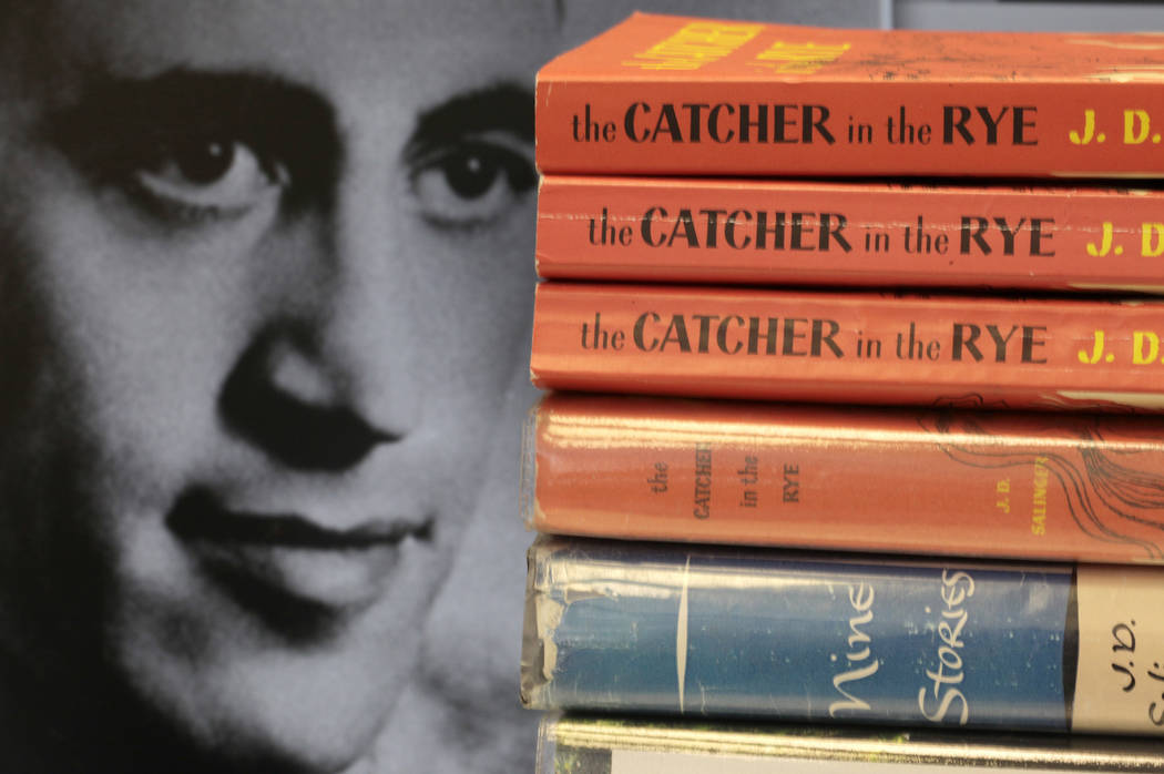 """Copies of J.D. Salinger's classic novel """"The Catcher in the Rye"""" as well as his volume of short stories called """"Nine Stories"""" are seen at the Orange Public Library in Orange Village, Ohio. (AP Pho ..."""