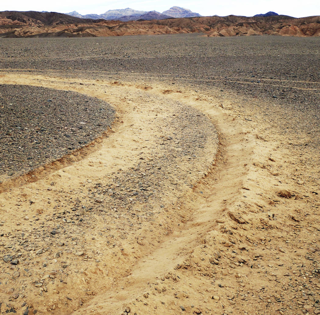 This January 2019 photo shows vehicle tracks in an area of Death Valley National Park, Calif., that park staff says can leave a lasting trench. (National Park Service via AP)