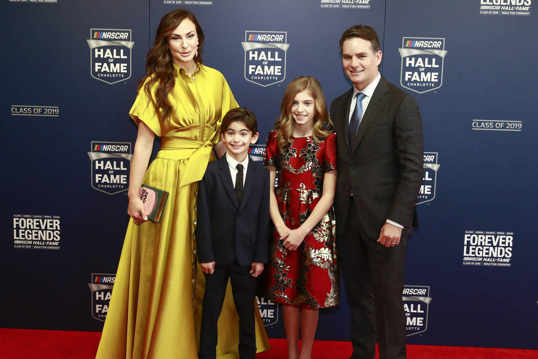 Former NASCAR driver Jeff Gordon, right, and his family from left: Ingrid Vandebosch, son Leo Benjamin and daughter Ella Sofia pose for photos before the NASCAR Hall of Fame induction ceremony for ...