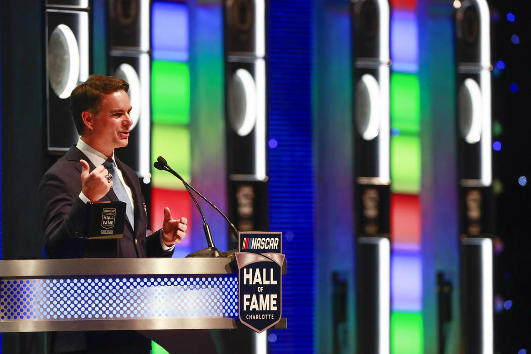 Jeff Gordon speaks during NASCAR Hall of Fame induction ceremony Friday, Feb. 1, 2019, in Charlotte, N.C. (AP Photo/Jason E. Miczek)