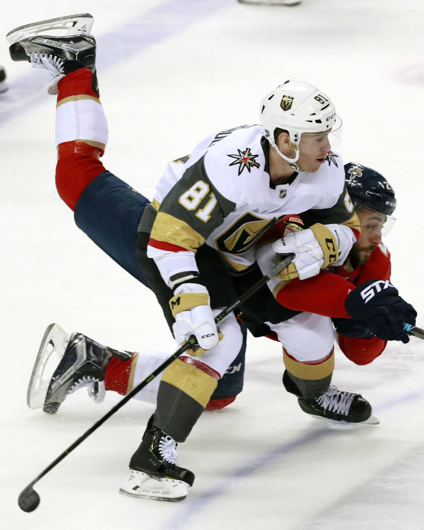 Vegas Golden Knights center Jonathan Marchessault (81) and Florida Panthers center Vincent Trocheck battle for the puck during the second period of an NHL hockey game, Saturday, Feb. 2, 2019, in S ...