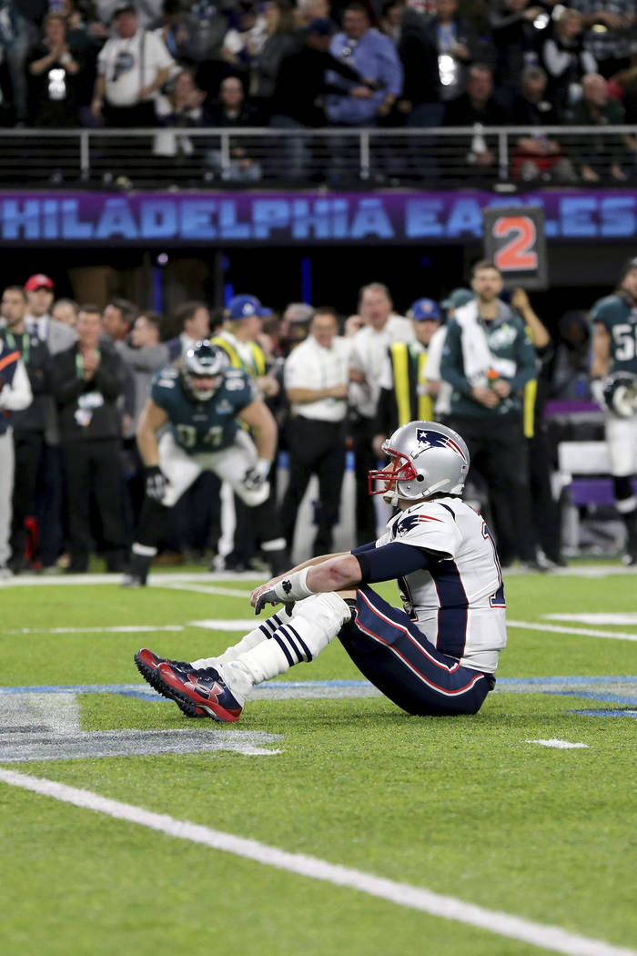 New England Patriots quarterback Tom Brady sits on the turf after fumbling late in the fourth quarter at Super Bowl 52 on Sunday, February 4, 2018 in Minneapolis. The Eagles won the game 41-33. (A ...