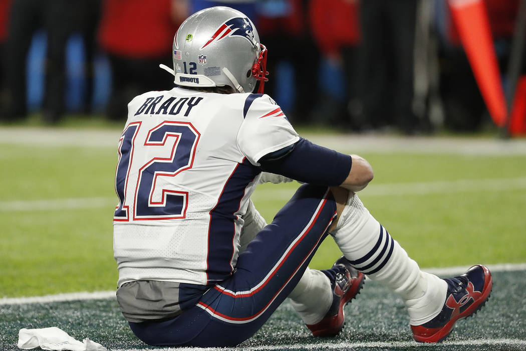 New England Patriots' Tom Brady sits on the field after the NFL Super Bowl 52 football game against the Philadelphia Eagles Sunday, Feb. 4, 2018, in Minneapolis. The Eagles won 41-33. (AP Photo/Ch ...