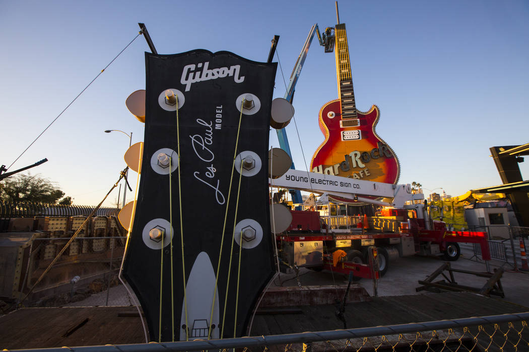 The headstock piece of the Hard Rock Cafe guitar sign is moved into the Neon Museum before being installed by YESCO employees in Las Vegas on Friday, Feb. 1, 2019. (Chase Stevens/Las Vegas Review- ...