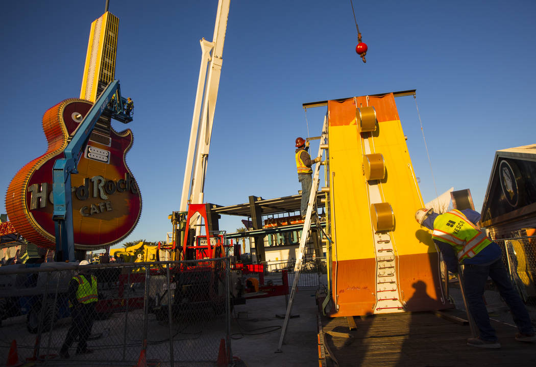 YESCO employees prepare to attach the headstock piece of the Hard Rock Cafe guitar as it is installed at the Neon Museum in Las Vegas on Friday, Feb. 1, 2019. (Chase Stevens/Las Vegas Review-Journ ...