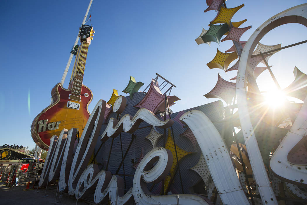 The headstock piece of the Hard Rock Cafe guitar sign, left, is installed YESCO employees at the Neon Museum in Las Vegas on Friday, Feb. 1, 2019. (Chase Stevens/Las Vegas Review-Journal) @cssteve ...