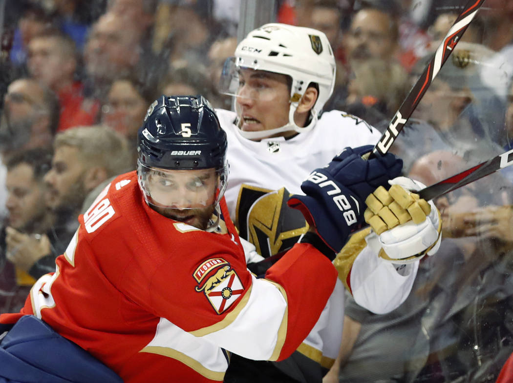 Florida Panthers defenseman Aaron Ekblad (5) slams Vegas Golden Knights left wing Tomas Nosek into the boards during the first period of an NHL hockey game, Saturday, Feb. 2, 2019 in Sunrise, Fla. ...