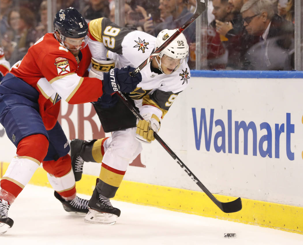 Florida Panthers defenseman Aaron Ekblad (5) and Vegas Golden Knights left wing Tomas Nosek (92) battle for the puck during the first period of an NHL hockey game, Saturday, Feb. 2, 2019, in Sunri ...