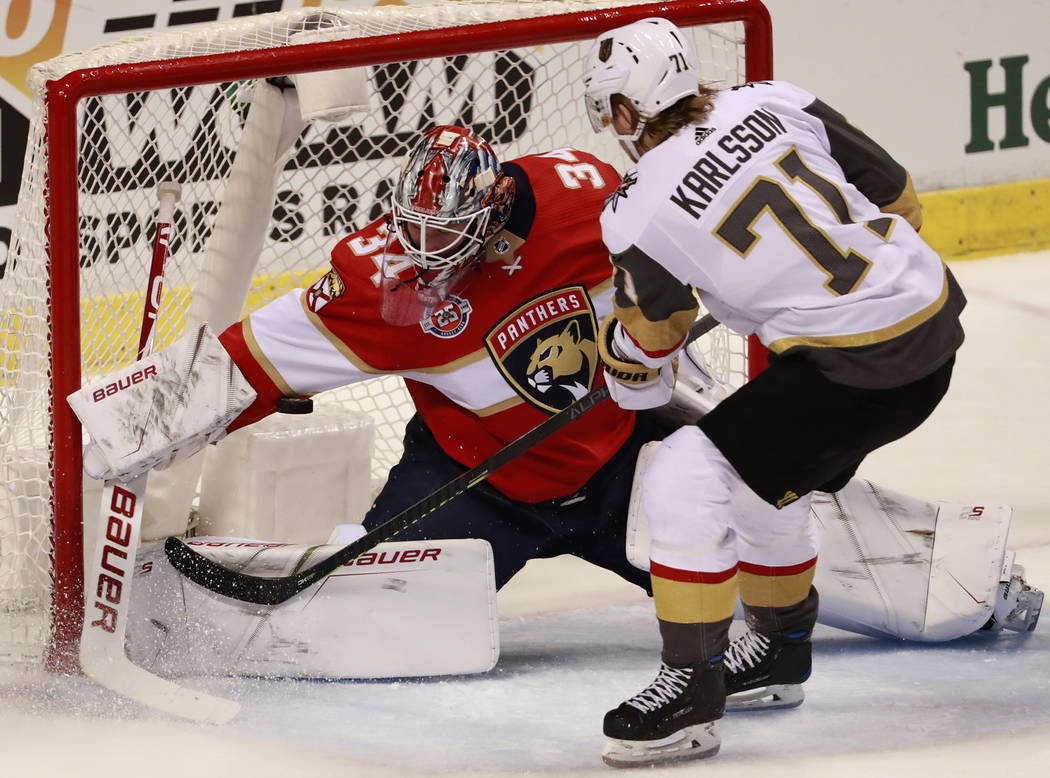 Vegas Golden Knights center William Karlsson (71) attempts to shoot at Florida Panthers goaltender James Reimer (34) during the second period of an NHL hockey game, Saturday, Feb. 2, 2019, in Sunr ...