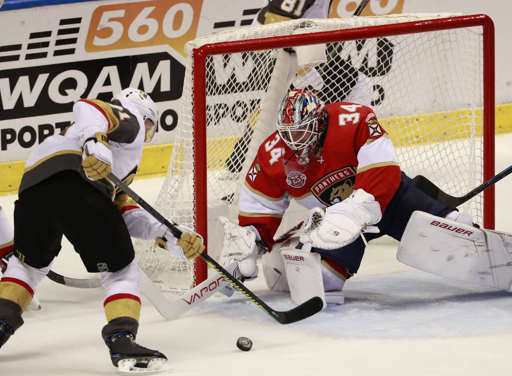 Vegas Golden Knights center William Karlsson, left, attempts to shoot at Florida Panthers goaltender James Reimer (34) during the second period of an NHL hockey game, Saturday, Feb. 2, 2019 in Sun ...