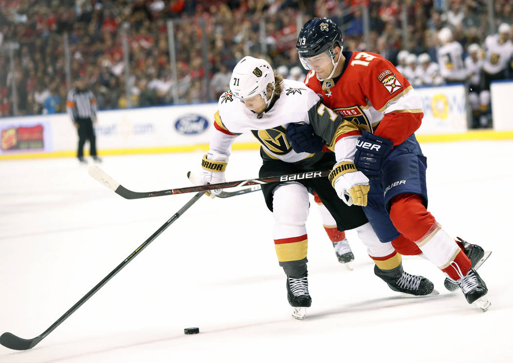 Vegas Golden Knights center William Karlsson (71) and Florida Panthers defenseman Mark Pysyk (13) battle for the puck during the first period of an NHL hockey game, Saturday, Feb. 2, 2019 in Sunri ...