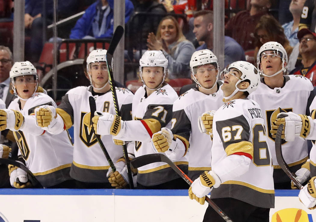 Vegas Golden Knights left wing Max Pacioretty (67) is congratulated by teammates after he scored during the first period of an NHL hockey game against the Florida Panthers, Saturday, Feb. 2, 2019, ...