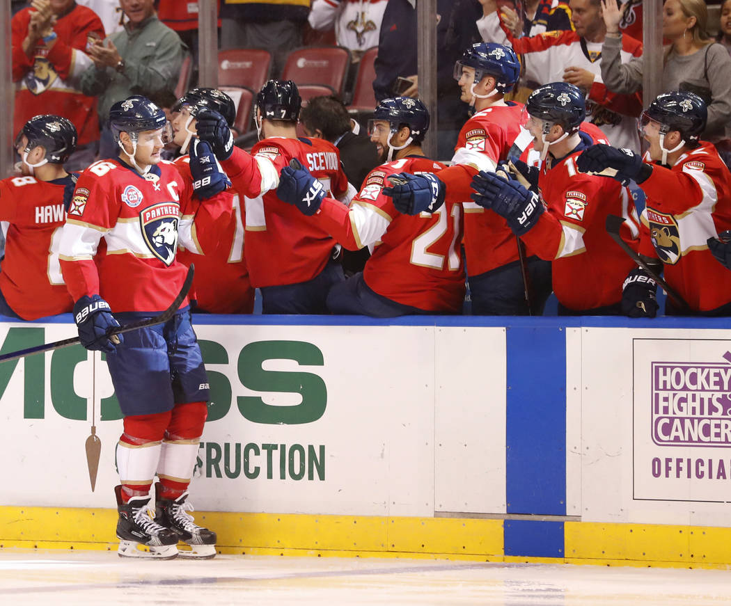 Florida Panthers center Aleksander Barkov (16) is congratulated by teammates after scoring during the first period of an NHL hockey game against the Vegas Golden Knights, Saturday, Feb. 2, 2019, i ...
