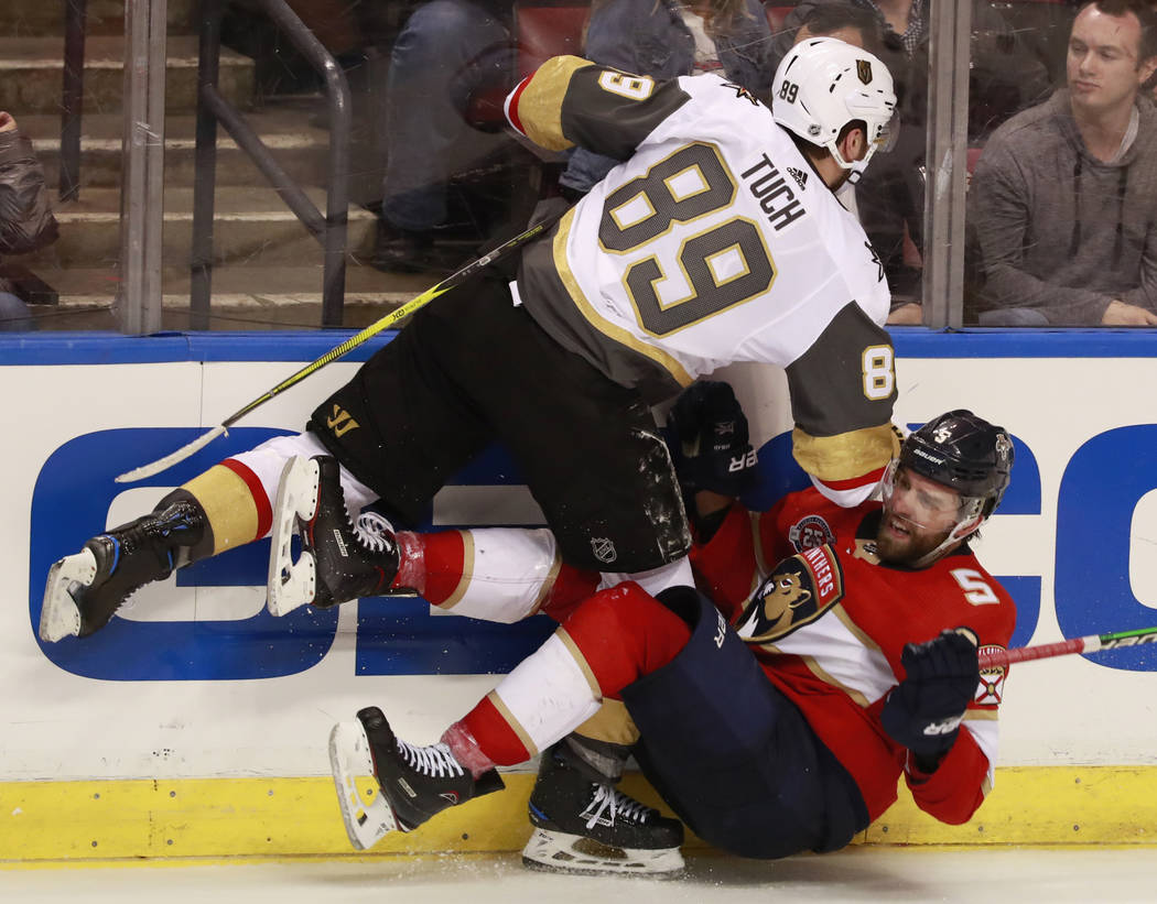 Vegas Golden Knights right wing Alex Tuch (89) slams Florida Panthers defenseman Aaron Ekblad (5) during the third period of an NHL hockey game, Saturday, Feb. 2, 2019 in Sunrise, Fla. (AP Photo/W ...