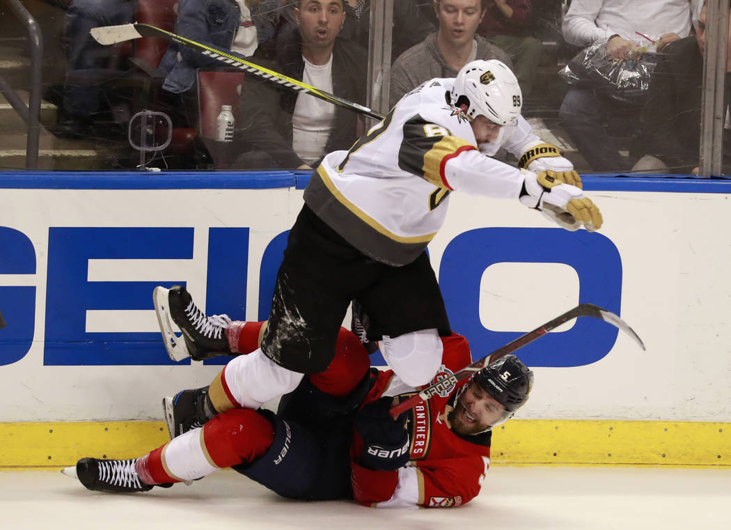 Vegas Golden Knights right wing Alex Tuch (89) slams Florida Panthers defenseman Aaron Ekblad (5) during the third period of an NHL hockey game, Saturday, Feb. 2, 2019 in Sunrise, Fla. The Panther ...