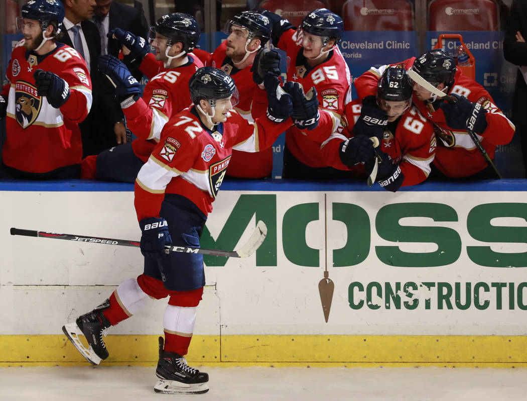 Florida Panthers center Frank Vatrano (72) is congratulated by teammates after he scored during the third period of an NHL hockey game against the Vegas Golden Knights, Saturday, Feb. 2, 2019 in S ...
