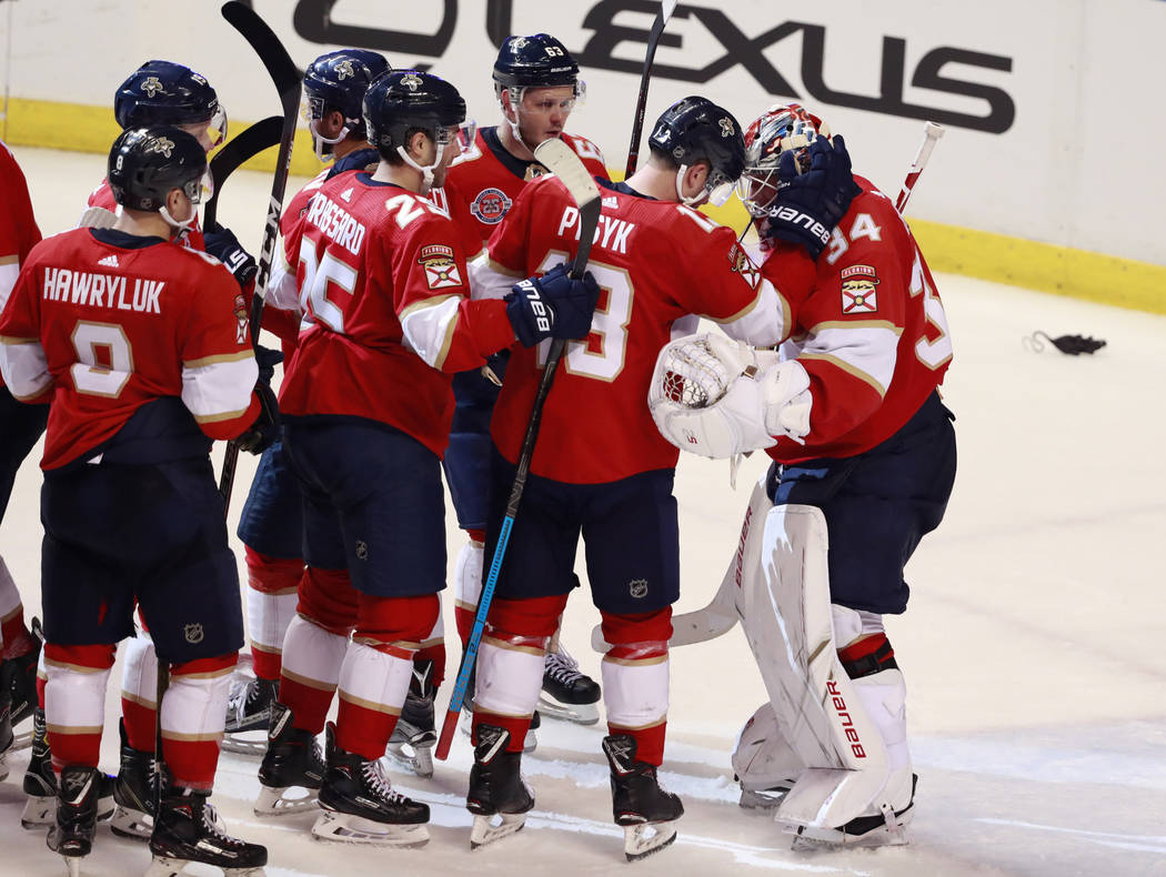 Teammates congratulate Florida Panthers goaltender James Reimer, right, after they defeated the Vegas Golden Knights during an NHL hockey game, Saturday, Feb. 2, 2019, in Sunrise, Fla. (AP Photo/W ...