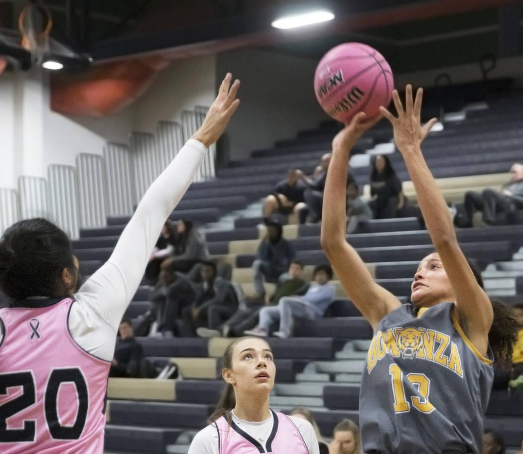 Bonanza senior Macyn Raleigh (13) shoots a corner jump shot over Shadow Ridge sophomore Nadia Morales (20) in the first quarter on Monday, Feb. 4, 2019, at Shadow Ridge High School, in Las Vegas. ...