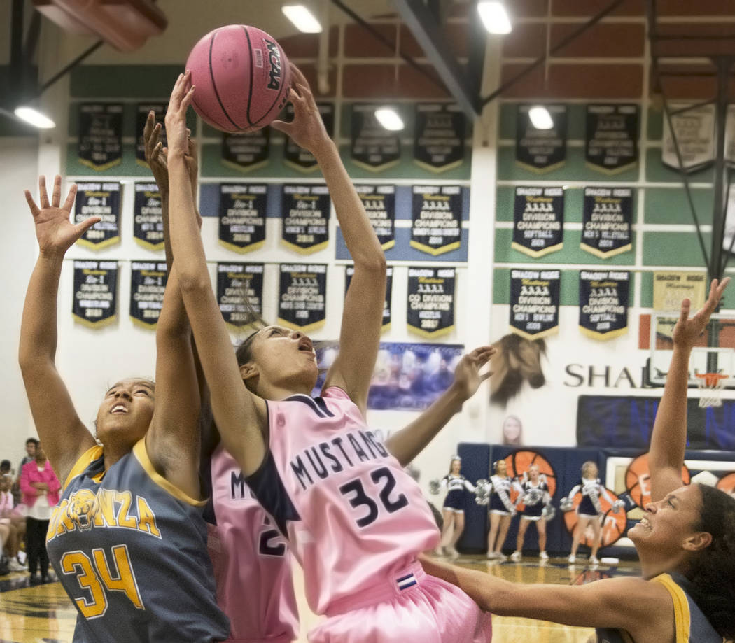Shadow Ridge junior Christina Thames (32) fights for a rebound with Bonanza sophomore Saphire Mathews (34) in the first quarter on Monday, Feb. 4, 2019, at Shadow Ridge High School, in Las Vegas. ...