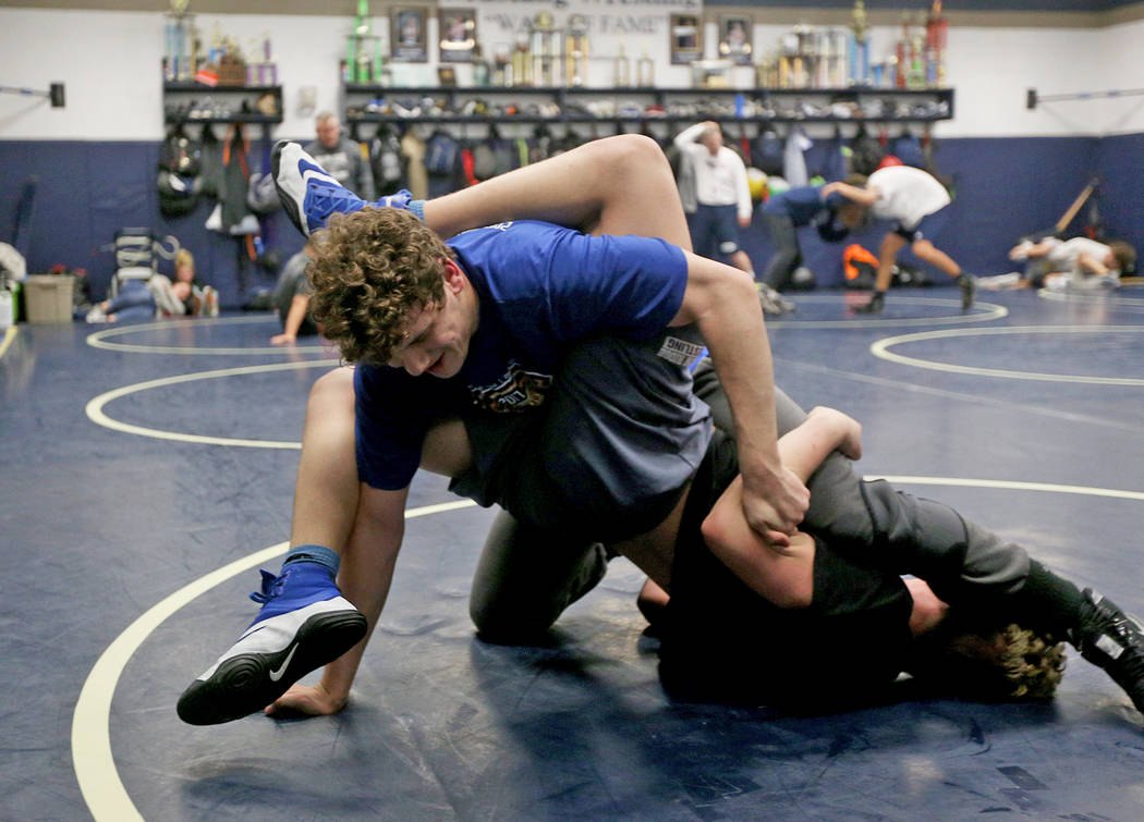 Ashton King, bottom, wrestles against Noah Gallardo at Shadow Ridge High School in Las Vegas, Monday, Feb. 4, 2019. (Rachel Aston/Las Vegas Review-Journal) @rookie__rae