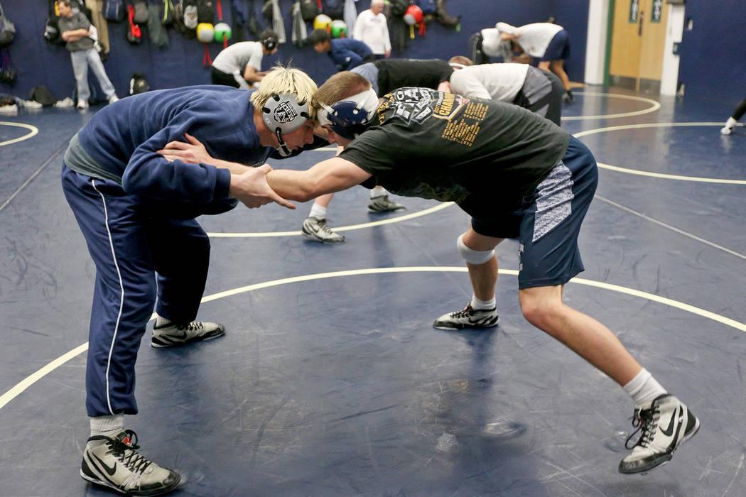 Kody Presser, right, wrestles against Marc Williams at Shadow Ridge High School in Las Vegas, Monday, Feb. 4, 2019. (Rachel Aston/Las Vegas Review-Journal) @rookie__rae