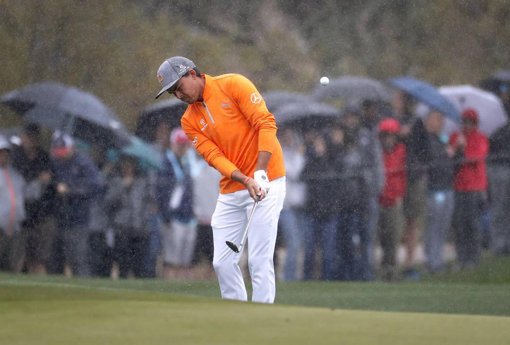 Rickie Fowler hits onto the 11th green during the final round of the Phoenix Open PGA golf tournament, Sunday, Feb. 3, 2019, in Scottsdale, Ariz. (AP Photo/Matt York)
