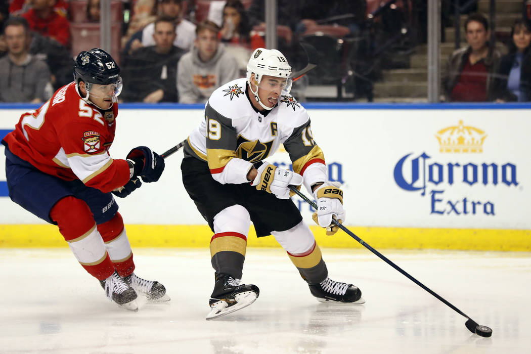 Vegas Golden Knights right wing Reilly Smith (19) skates to the net followed by Florida Panthers defenseman MacKenzie Weegar (52) during the first period of an NHL hockey game, Saturday, Feb. 2, 2 ...