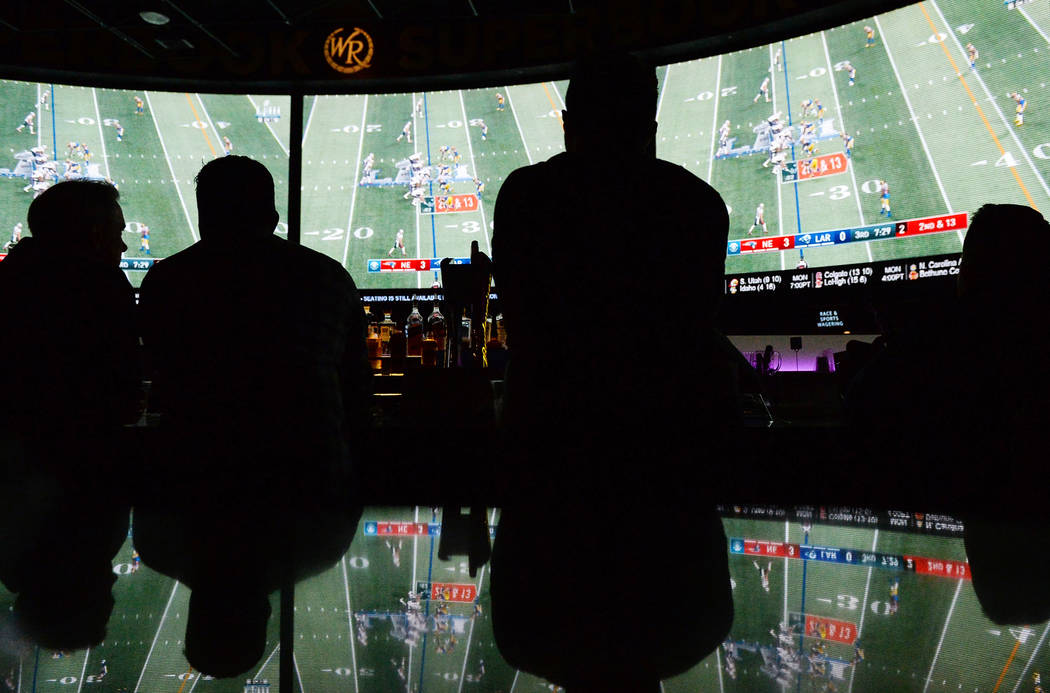 People watch Super Bowl LIII at the Westgate Superbook in Las Vegas, Sunday, Feb. 3, 2019. Caroline Brehman/Las Vegas Review-Journal