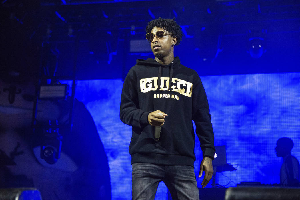 FILE - In this Sunday, Oct. 28, 2018, file photo, 21 Savage performs at the Voodoo Music Experience in City Park in New Orleans. Authorities in Atlanta say Grammy-nominated rapper 21 Savage is in ...