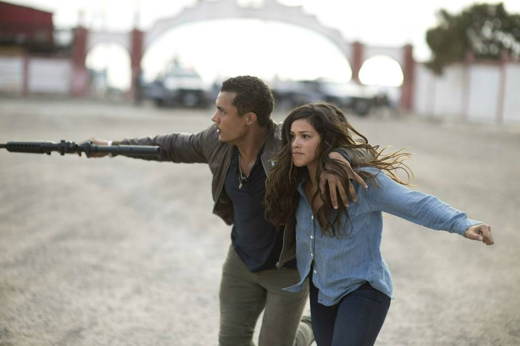 """This image released by Sony Pictures shows Ismael Cruz, left, and Gina Rodríguez in a scene from """"Miss Bala."""" (Gregory Smith/Sony Pictures via AP)"""