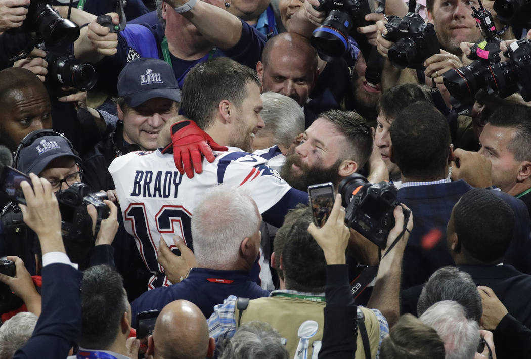 New England Patriots' Julian Edelman, right, and New England Patriots' Tom Brady celebrate after the NFL Super Bowl 53 football game against the Los Angeles Rams, Sunday, Feb. 3, 2019, in Atlanta. ...