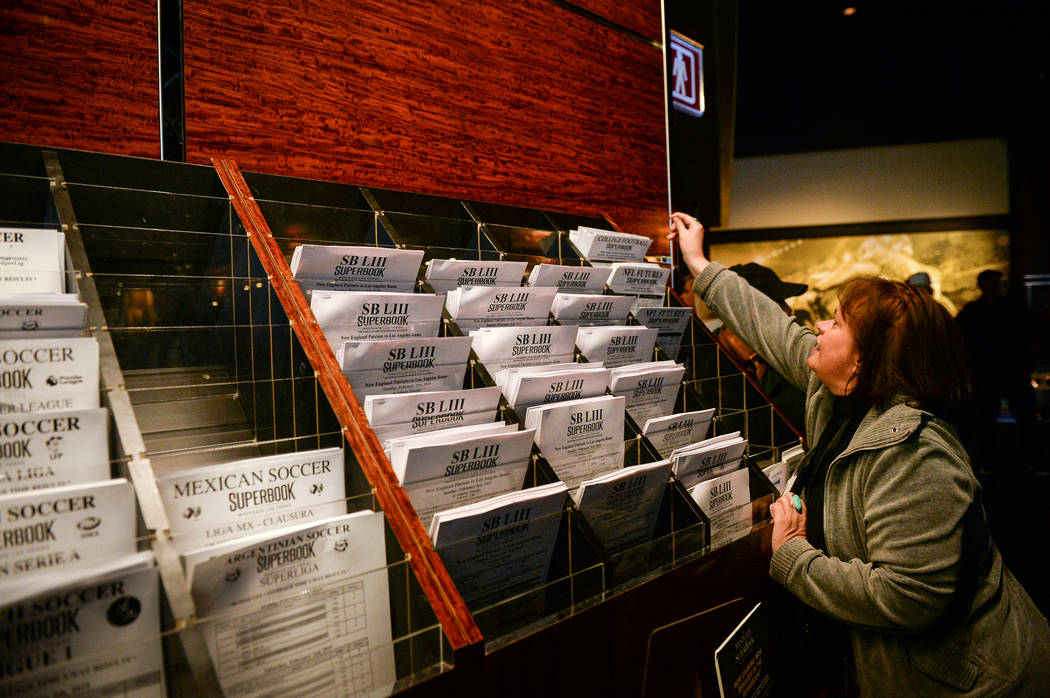 Lisa Skjerven reaches for betting papers to place prop bets for the Super Bowl at the Westgate Superbook in Las Vegas in Las Vegas, Sunday, Feb. 3, 2019. Caroline Brehman/Las Vegas Review-Journal