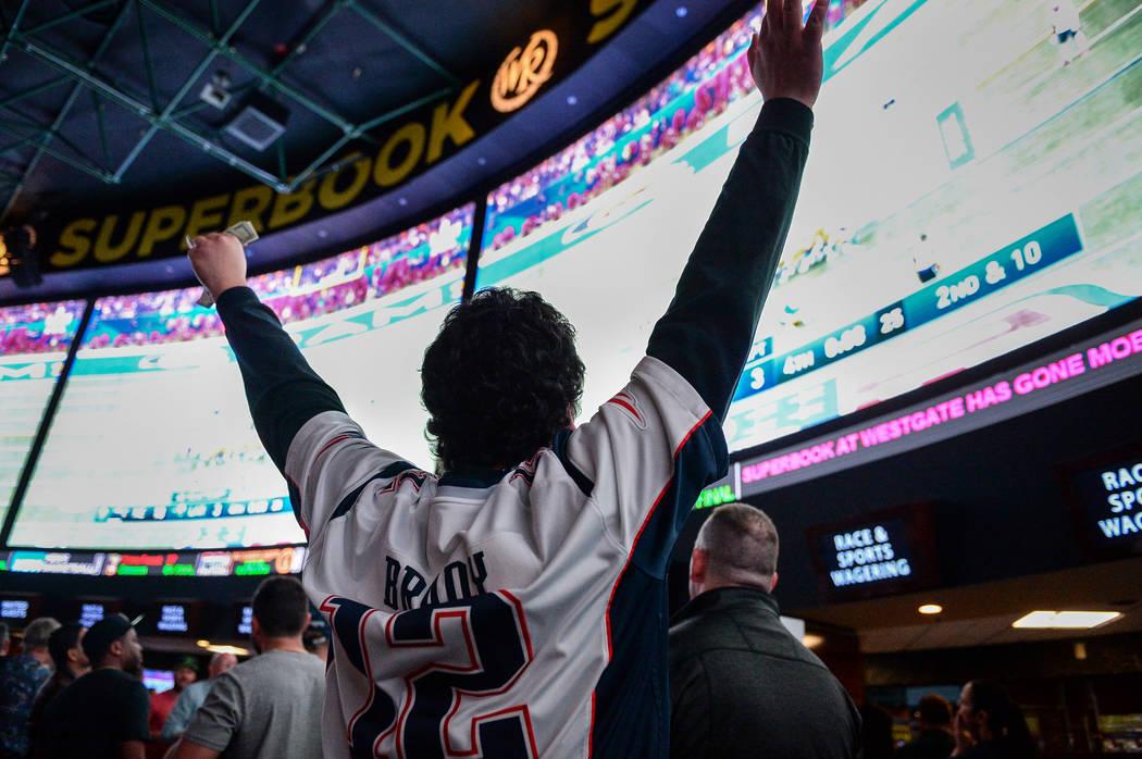 People react as they watch Super Bowl LIII at the Westgate Superbook in Las Vegas, Sunday, Feb. 3, 2019. Caroline Brehman/Las Vegas Review-Journal