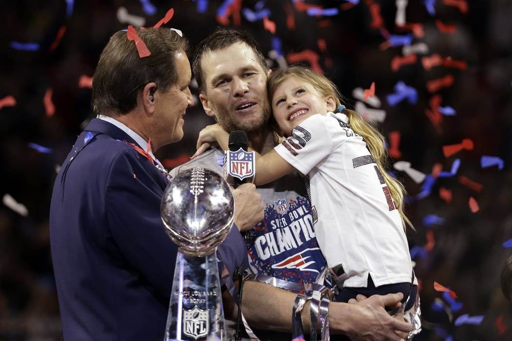 New England Patriots' Tom Brady holds his daughter, Vivian, after the NFL Super Bowl 53 football game against the Los Angeles Rams, Sunday, Feb. 3, 2019, in Atlanta. The Patriots won 13-3. (AP Pho ...