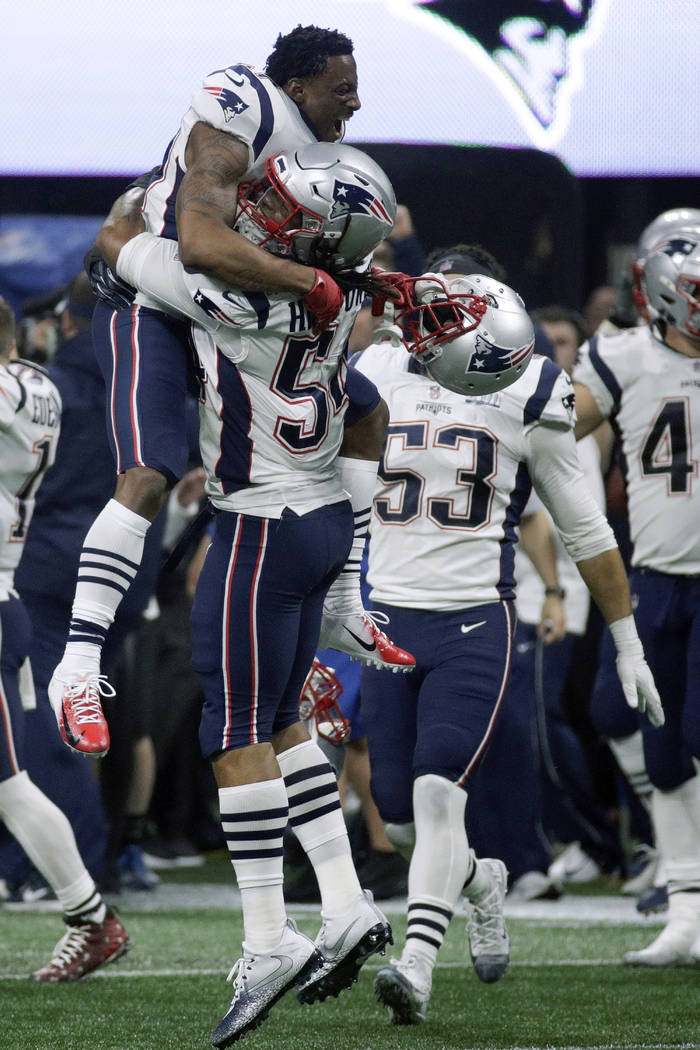New England Patriots' Dont'a Hightower (54) gives a lift to a teammate as they celebrate winning the NFL Super Bowl 53 football game 13-3 over the Los Angeles Rams, Sunday, Feb. 3, 2019, in Atlant ...