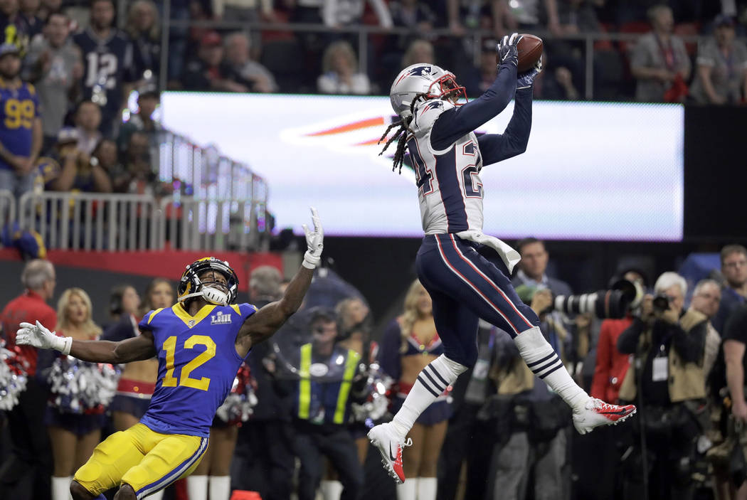 New England Patriots' Stephon Gilmore, right, intercepts a pass intended for Los Angeles Rams' Brandin Cooks (12) during the second half of the NFL Super Bowl 53 football game Sunday, Feb. 3, 2019 ...
