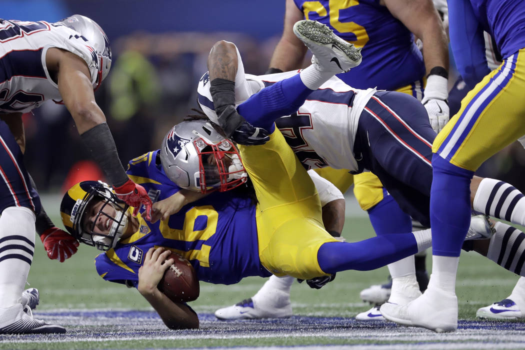 New England Patriots' Dont'a Hightower, top, sacks Los Angeles Rams' Jared Goff (16) during the first half of the NFL Super Bowl 53 football game Sunday, Feb. 3, 2019, in Atlanta. (AP Photo/John B ...