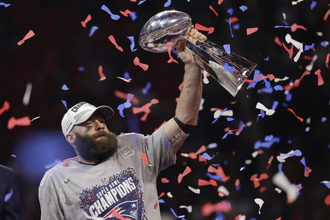 New England Patriots' Julian Edelman holds the Vince Lombardi Trophy, after the NFL Super Bowl 53 football game against the Los Angeles Rams, Sunday, Feb. 3, 2019, in Atlanta. The Patriots won 13- ...
