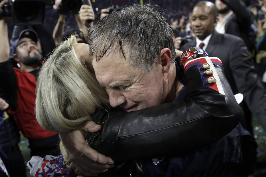 New England Patriots head coach Bill Belichick and girlfriend Linda Holliday celebrate after the NFL Super Bowl 53 football game against the Los Angeles Rams, Sunday, Feb. 3, 2019, in Atlanta. The ...
